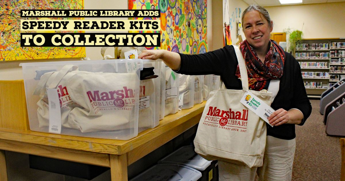 Kathryn Poulter, Youth Services Librarian at the Marshall Public Library, stands with one of the new