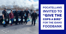 Pocatello Police Officers holding donated turkeys.