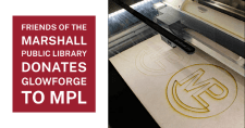 The MPL's new Glowforge etches the Library's logo into a piece of wood.